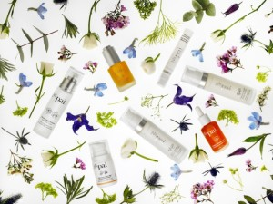 PAI skincare products and flowers